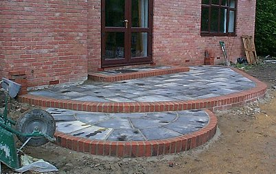 7 August 2001 U2022 The Pond Is Filled To Get The Level For The Edging Of  Stones . The Patio Step Is Edged With Brick.